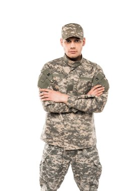 handsome soldier in uniform standing with crossed arms isolated on white
