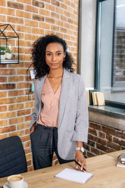 beautiful african american Casual businesswoman looking at camera in loft office