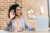 Fotografie smiling african american Casual businesswoman using laptop while having Video Chat