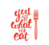red plastic bright fork near you are what you eat lettering isolated on white