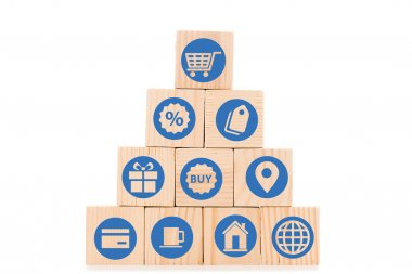 Pyramid made of wooden blocks with blue shopping icons isolated on white stock vector