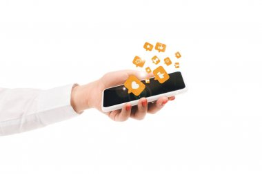 Cropped view of woman holding smartphone with social media icons isolated on white stock vector