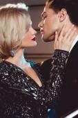 beautiful seductive young woman embracing handsome man