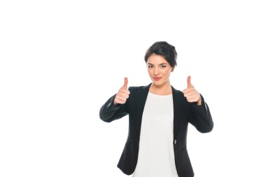 Cheerful mixed race businesswoman showing thumbs up while looking at camera isolated on white stock vector