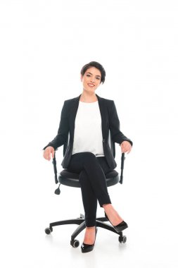 Smiling mixed race businesswoman sitting in office chair and smiling at camera on white background stock vector