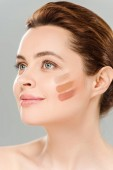 beautiful cheerful woman with eye shadow brown palette on face isolated on grey