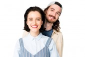 portrait shot of young couple smiling at camera isolated on white