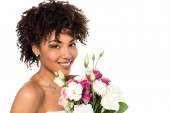 happy african american girl in wedding dress holding bouquet and looking at camera isolated on white