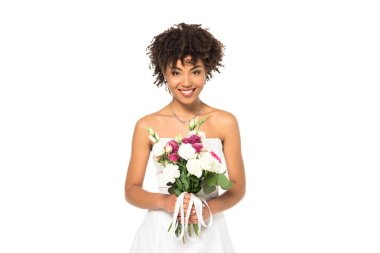 Happy african american bride holding bouquet and looking at camera isolated on white stock vector
