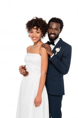 Smiling african american bridegroom and bride looking at camera isolated on white stock vector