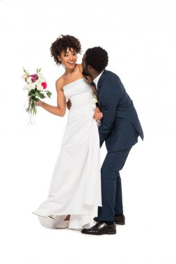 African american bridegroom touching happy bride with flowers isolated on white stock vector