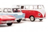 selective focus of toy cars and bus on white