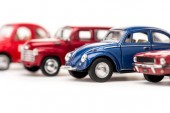 selective focus of colorful toy cars on white