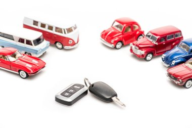 Keys and colorful toy cars on white surface stock vector