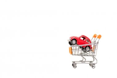 Red toy car in shopping cart isolated on white stock vector