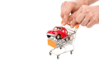 Cropped view of man holding shopping cart with red toy car isolated on white stock vector