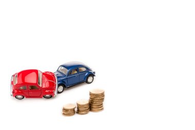 Red and blue toy cars and golden coins on white stock vector