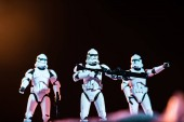 KYIV, UKRAINE - MAY 25, 2019: selective focus of white imperial stormtroopers with guns on cosmic planet