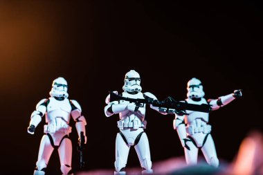 KYIV, UKRAINE - MAY 25, 2019: selective focus of white imperial stormtroopers with guns on cosmic planet stock vector