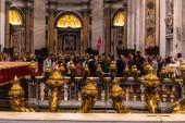 ROME, ITALY - JUNE 28, 2019: selective focus of people in basilica of saint peter in vatican