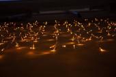 illumination with light bulbs garland on wall in rome, italy