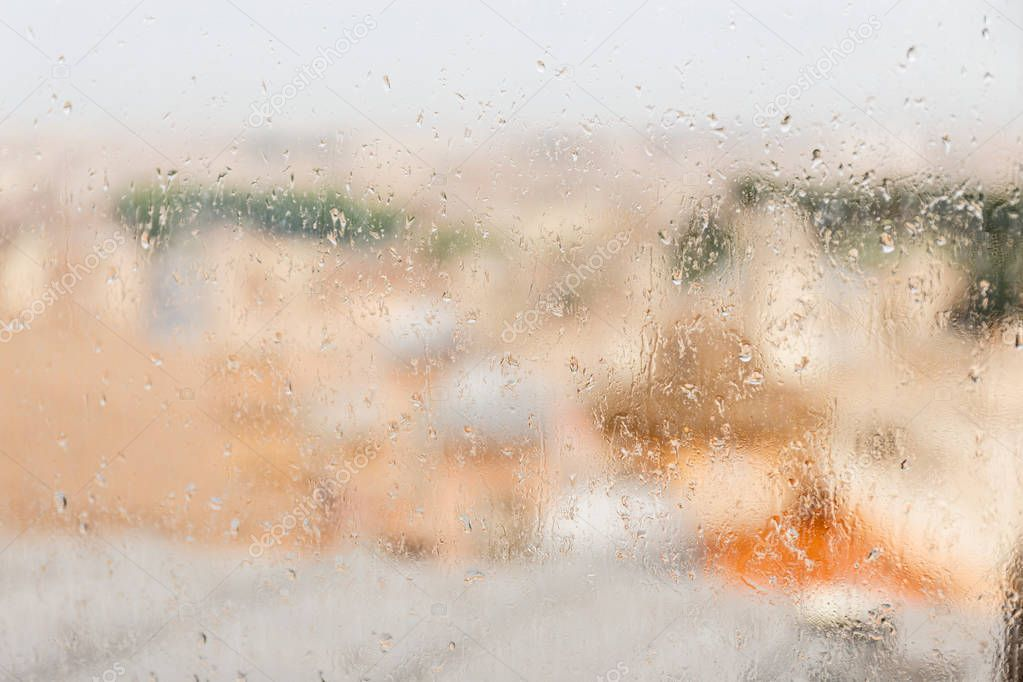 wet window with rain drops in rome, italy