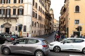 ROME, ITALY - JUNE 28, 2019: crowd of people and cars on street near buildings