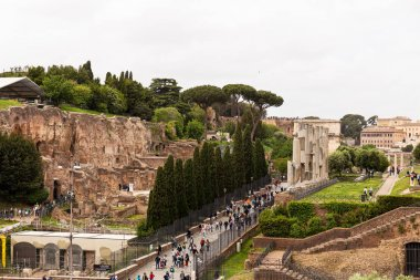 ROME, ITALY - JUNE 28, 2019: crowd of tourists walking at roman forum stock vector