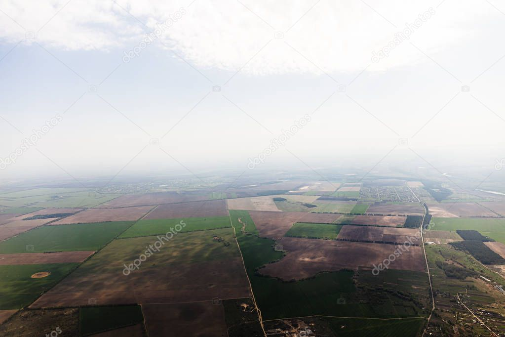 aerial view of fields under clouds in rome, italy