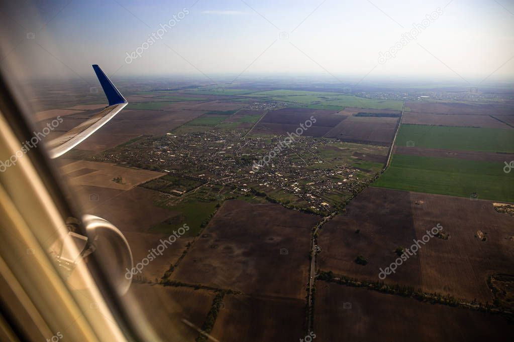 aerial view of country from airplane window in rome, italy