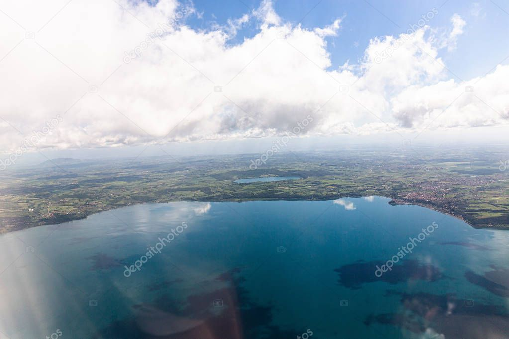 aerial view of sea under blue sky with clouds in rome, italy