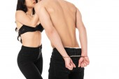 Fotografie cropped view of sexy couple with handcuffs isolated on white