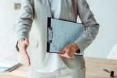 cropped view of recruiter gesturing and holding clipboard