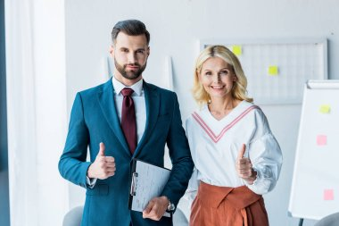 handsome recruiter and blonde woman showing thumbs up in office