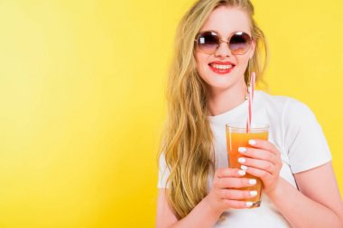 beautiful smiling girl with cocktail glass Isolated On yellow