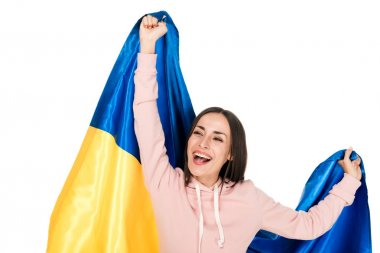 Happy young girl holding satin flag of Ukraine and rejoicing isolated on white stock vector