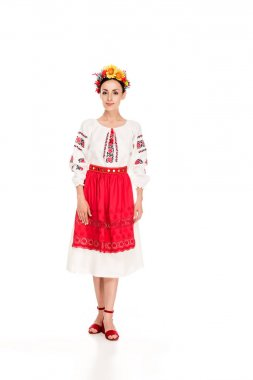 Full length view of brunette young woman in national Ukrainian costume isolated on white stock vector