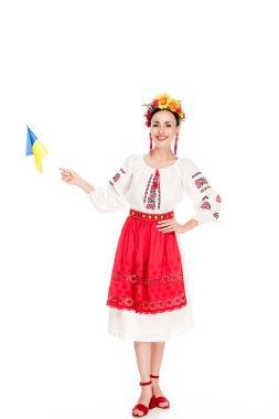 Brunette young woman in national Ukrainian costume holding flag of Ukraine isolated on white stock vector