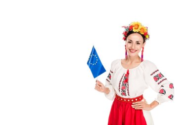 Happy brunette young woman in national Ukrainian costume holding European flag isolated on white stock vector