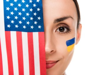 Smiling young woman with painted Ukrainian flag on face holding American flag isolated on white stock vector