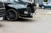 crashed vehicle after car accident near modern automobiles