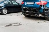 crashed blue car after car accident near modern automobile