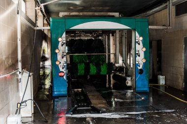 automatic car wash service with clean and green brushes