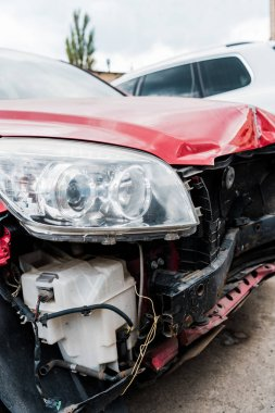 selective focus of damaged red vehicle after car accident