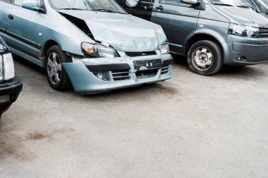 crashed bonnet car after car accident near modern automobiles