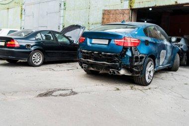 Damaged blue car after car accident near modern automobile stock vector