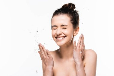 Happy naked young brunette woman with natural beauty and closed eyes washing up with clean water splash isolated on white stock vector