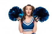 excited cheerleader girl in blue uniform dancing with pompoms isolated on white
