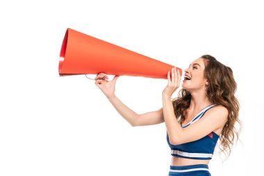 happy cheerleader girl in blue uniform with pompom using orange megaphone isolated on white