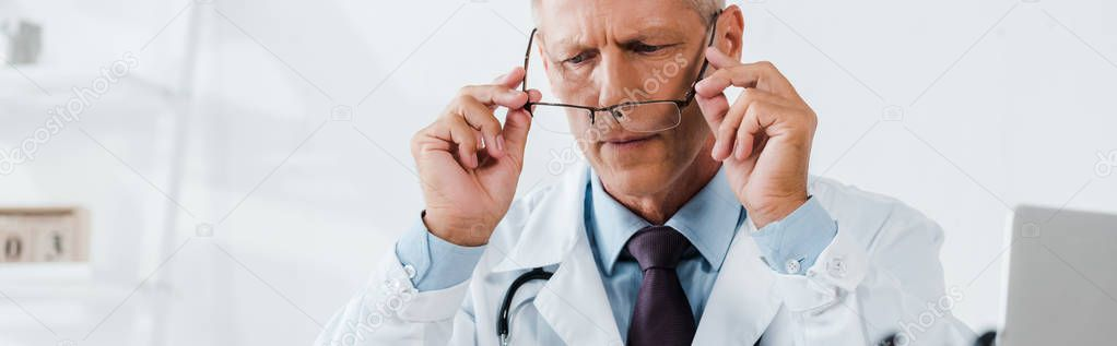 Panoramic shot of doctor in white coat holding glasses stock vector